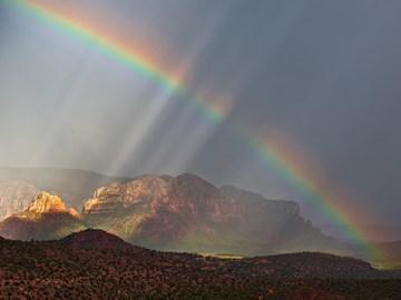 увидеть радугу примета вечером